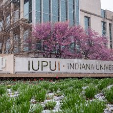 A late snow fall coats the IUPUI campus on Tuesday, April 20, 2021.Physical-distancing guidelines were followed while capturing this photo.