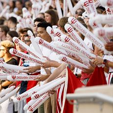 Students clap Students clap inflatable noise sticks together during the Traditions and Spirit of IU at Memorial Stadium on Friday, Aug. 23, 2019.