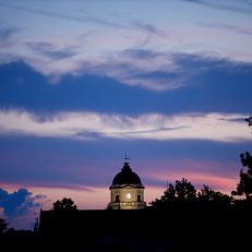 The sun sets behind the Monroe County Courthouse as pictured on a summer evening from IU Bloomington on Wednesday, July 1, 2020.