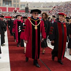 Indiana University President Michael A. McRobbie, left, and IU Trustee Randall L. Tobias lead the platform party to the stage during the IU Undergraduate Commencement on Saturday, May 9, 2015, at Memorial Stadium in Bloomington.