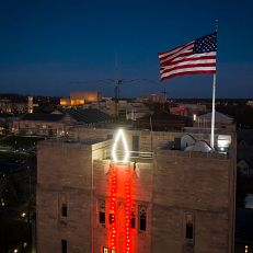 A holiday candle illuminates the Indiana Memorial Union Student Activities Tower as pictured from the air at IU Bloomington on Thursday, Nov. 19, 2020.