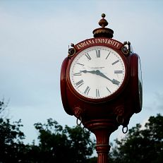An iconic red clock stands outside Woodburn Hall on a summer evening at IU Bloomington on Wednesday, July 1, 2020.