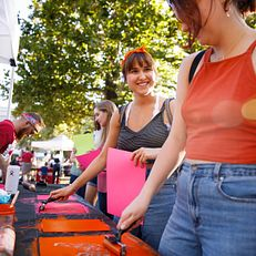 Students including Indiana University junior Jessica McClintock, center, create place mats at the IU Corps table during the First Thursdays Festival on the Arts Plaza at IU Bloomington on Thursday, Oct. 3, 2019.