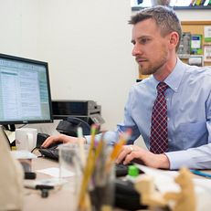 Ben Motz works at his computer on Wednesday, Feb. 25, 2015, in the Psychology Building. Motz, a Senior Lecturer and Director of Pedagogy, won the President's Award in Teaching and will be honored at the Distinguished Teaching Awards.
