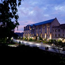 Hodge Hall at the Indiana University Kelly School of Business is illuminated on a summer evening at IU Bloomington on Thursday, Aug. 22, 2019.