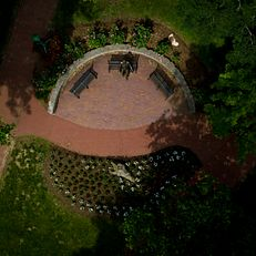 A sculpture of former Indiana University President Herman B Wells is pictured in the Old Crescent from the air on a summer day at IU Bloomington on Thursday, June 6, 2019.