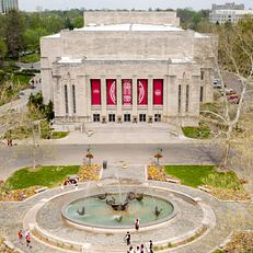 The IU Auditorium and Showalter Fountain are pictured from the air in the Arts Plaza at Indiana University Bloomington on Wednesday, May 2, 2018.