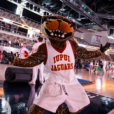 Jawz, the IUPUI mascot, performs before a semifinal of the Horizon League Women's Basketball Championship at Indiana Farmers Coliseum in Indianapolis on Monday, March 9, 2020.
