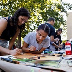 Indiana University senior Rhianna Ladd, left, and junior Brianny Alvarado paint during the First Thursdays Festival on the Arts Plaza at IU Bloomington on Thursday, Sept. 5, 2019.