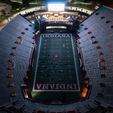 """Patrons watch """"The Mummy"""" on Memorial Stadium's jumbotron at IU Bloomington on Thursday, Oct. 7, 2021. The film is part of the IU Cinema Under the Stars series. (Photo by James Brosher/Indiana University)"""