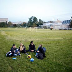 Students socialize in the Woodlawn field area on the campus of IUB, taken on Tuesday, Oct. 24, 2018.