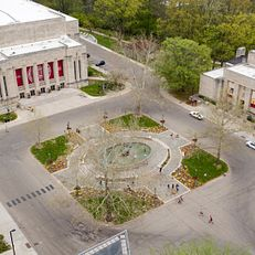 The IU Auditorium, left, Showalter Fountain, center, and the Lilly Library, right are pictured in the Arts Plaza at Indiana University Bloomington on Wednesday, May 2, 2018.