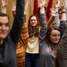 Indiana University student August Tuggle, center, takes part in warm up exercises with fellow members of the Singing Hoosiers during a practice at the Jacobs School of Music Annex Building on Friday, Jan. 11, 2019.