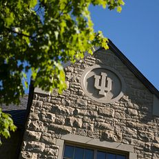 An IU logo adorns the side of the Hutton Honors College on a summer day on Friday, Aug. 7, 2015.