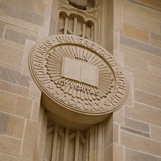 A limestone Indiana University Seal adorns the front of the Lilly Library on a summer day at IU Bloomington on Friday, May 17, 2019.