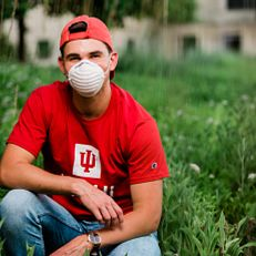 An IUPUI student wearing a mask sits outside the ICTC building. Physical-distancing guidelines were followed while capturing this photo. Photo taken Thursday, June 25, 2020.