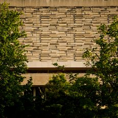 The exterior of the Herman B Wells Library is pictured on a summer evening at IU Bloomington on Thursday, May 23, 2019.