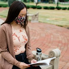 An IUPUI student wearing a mask studies at Ball Gardens. Physical-distancing guidelines were followed while capturing this photo. Photo taken Tuesday, June 23, 2020.