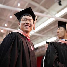 Graduates line up to cross the stage during the IU Graduate Commencement on Friday, May 8, 2015, in John Mellencamp Pavilion.