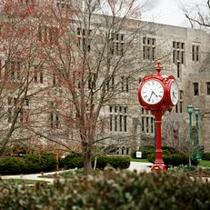 An iconic red clock stands outside of Woodburn Hall on a spring afternoon at Indiana University Bloomington on Friday, March 20, 2020.