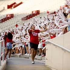 Indiana University Orientation Team member Drew Fox pumps up the crowd during the Traditions and Spirit of IU at Memorial Stadium on Friday, Aug. 23, 2019.