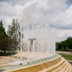 McKinney Fountain is pictured in front of the Bess Meshulam Simon Music Library and Recital Center at the Indiana University Jacobs School of Music on a summer day at IU Bloomington on Friday, May 17, 2019.