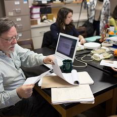 Richard Wilk looks through his notes notes before his Global Consumer Culture and the Environment class on Wednesday, March 4, 2015, at the Archaeology laboratory annex. Wilk, a Provost Professor of Anthropology, is a 2015 Distinguished Professor honoree.