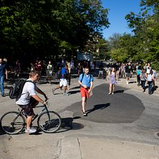 Students make their way to classes outside of Ballantine Hall during the first day of classes at Indiana University Bloomington on Monday, Aug. 24, 2015.