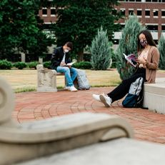 An IUPUI student wearing a mask, studies at Ball Gardens. Physical-distancing guidelines were followed while capturing this photo. Photo taken Tuesday, June 23, 2020.
