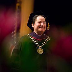 Indiana University Provost and Executive Vice President Lauren Robel smiles as she greets an honored student on stage during the Honors Convocation on Sunday, April 12, 2015, at the IU Auditorium.