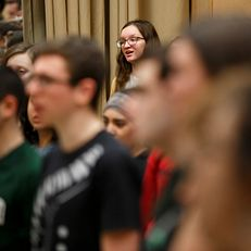 Indiana University student August Tuggle sings with fellow members of the Singing Hoosiers during a practice at the Jacobs School of Music Annex Building on Friday, Jan. 11, 2019.