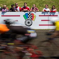 Spectators watch the action between turns one and two during the Men's Little 500 on Sunday, April 26, 2015, at Bill Armstrong Stadium.
