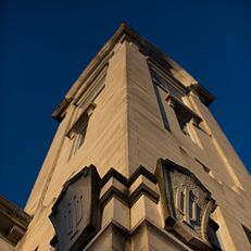 IU logos adorn the side of the Student Building tower on Tuesday, Feb. 24, 2015, in the Old Crescent.