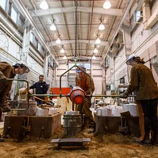 Herron sculpture students taking part in a pour of bronze and aluminum at the Eskanazi Fine Arts Center on Tuesday April 3, 2018.