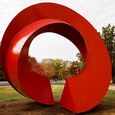 Indiana Arc, a sculpture by Charles Perry, stands outside the Eskenazi Museum of Art on a fall day at IU Bloomington on Thursday, Oct. 24, 2019.