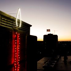 A holiday candle illuminates the Indiana Memorial Union Biddle Hotel and Conference Center tower as pictured from the air at IU Bloomington on Thursday, Nov. 19, 2020.