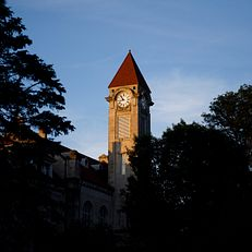 The Frances Morgan Swain Student Building clocktower is pictured on a summer evening at IU Bloomington on Thursday, June 27, 2019.
