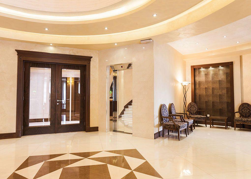 Masonite Interior Premium Wood Veneer Glass Doors in a Hotel Lobby