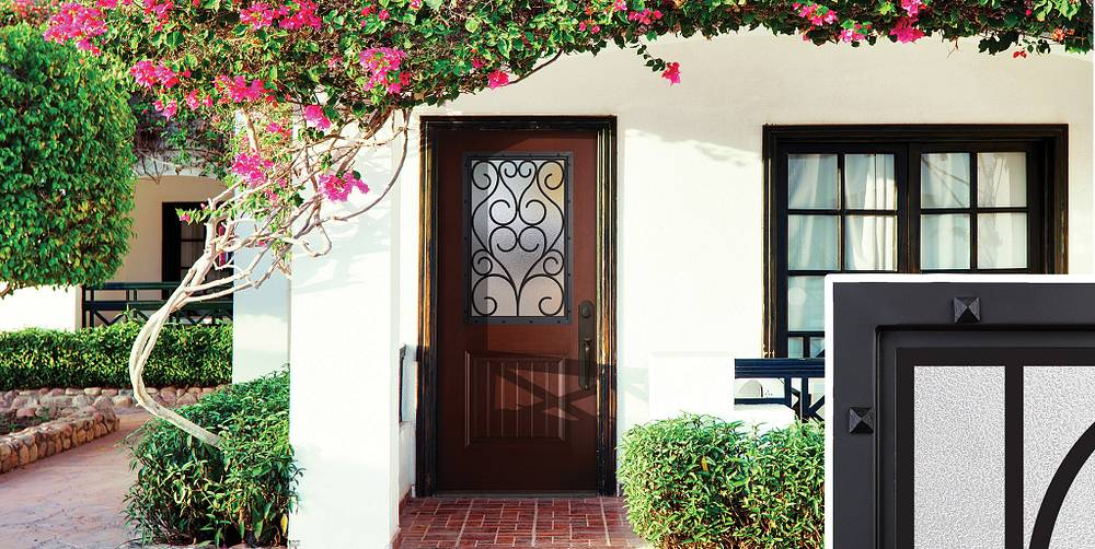 Masonite Wrought Iron frame for doors with glass set in rustic, Mediterranean-style home