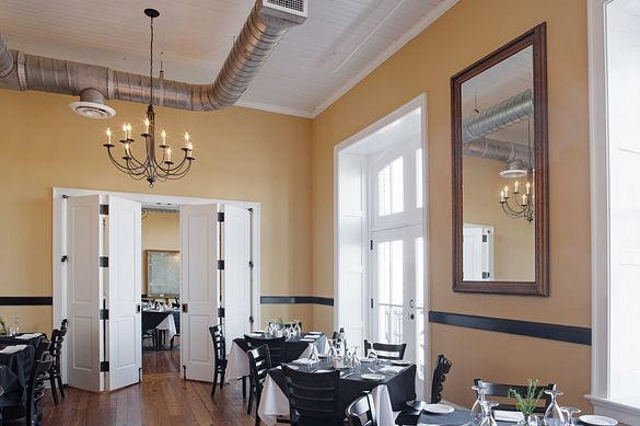 Vic's on the River features while double-folding stile and rail doors in a historic Southern dinner setting.