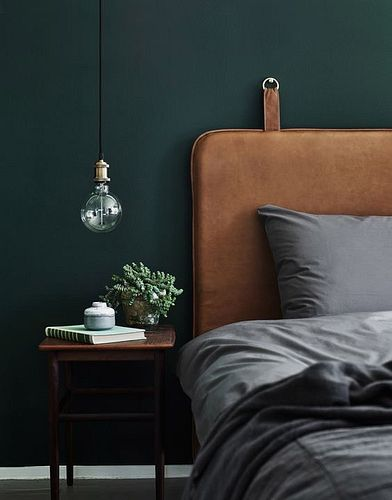 Nordic Noir bedroom with hanging headboard and gray bedding