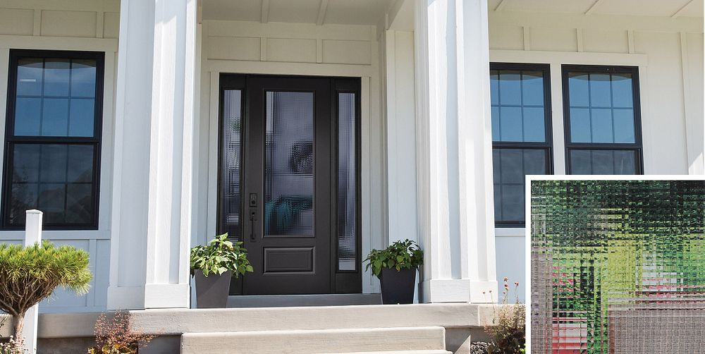Black door with black hardware and Cross Reed textured glass in large lite and sidelites