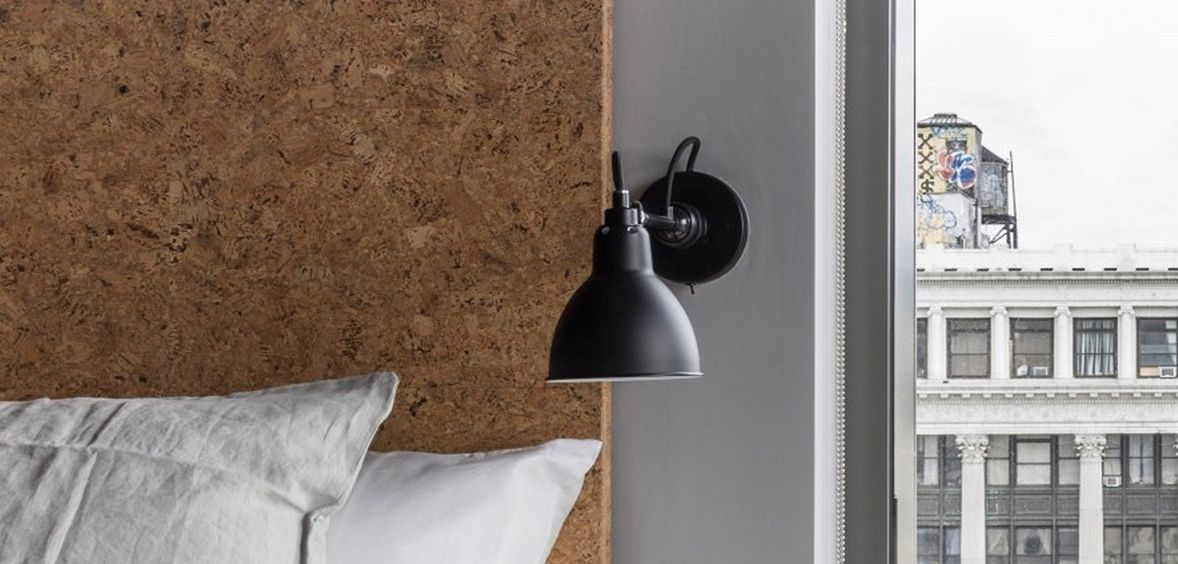 Cork headboard and moveable light fixture in a Live Work space