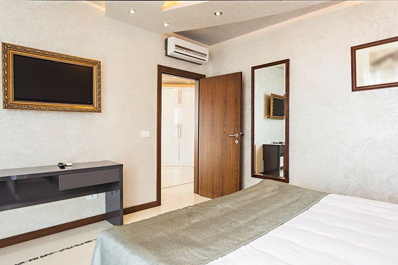 hotel room with open door