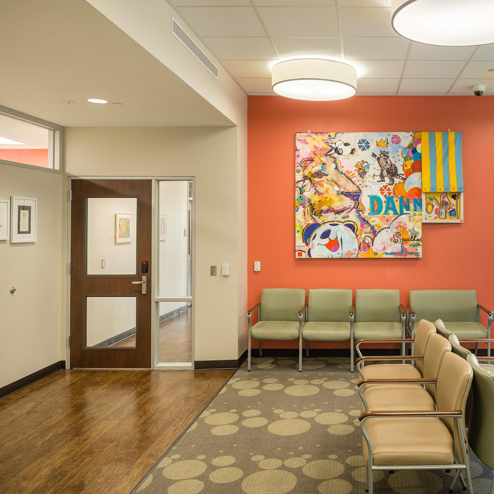 Heavy duty interior doors with glass in a hospital waiting room
