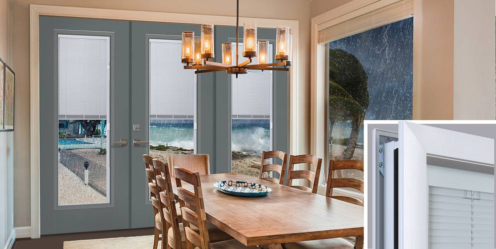 Impact-rated mini-blinds by Masonite in blue door showing coastal storm outside