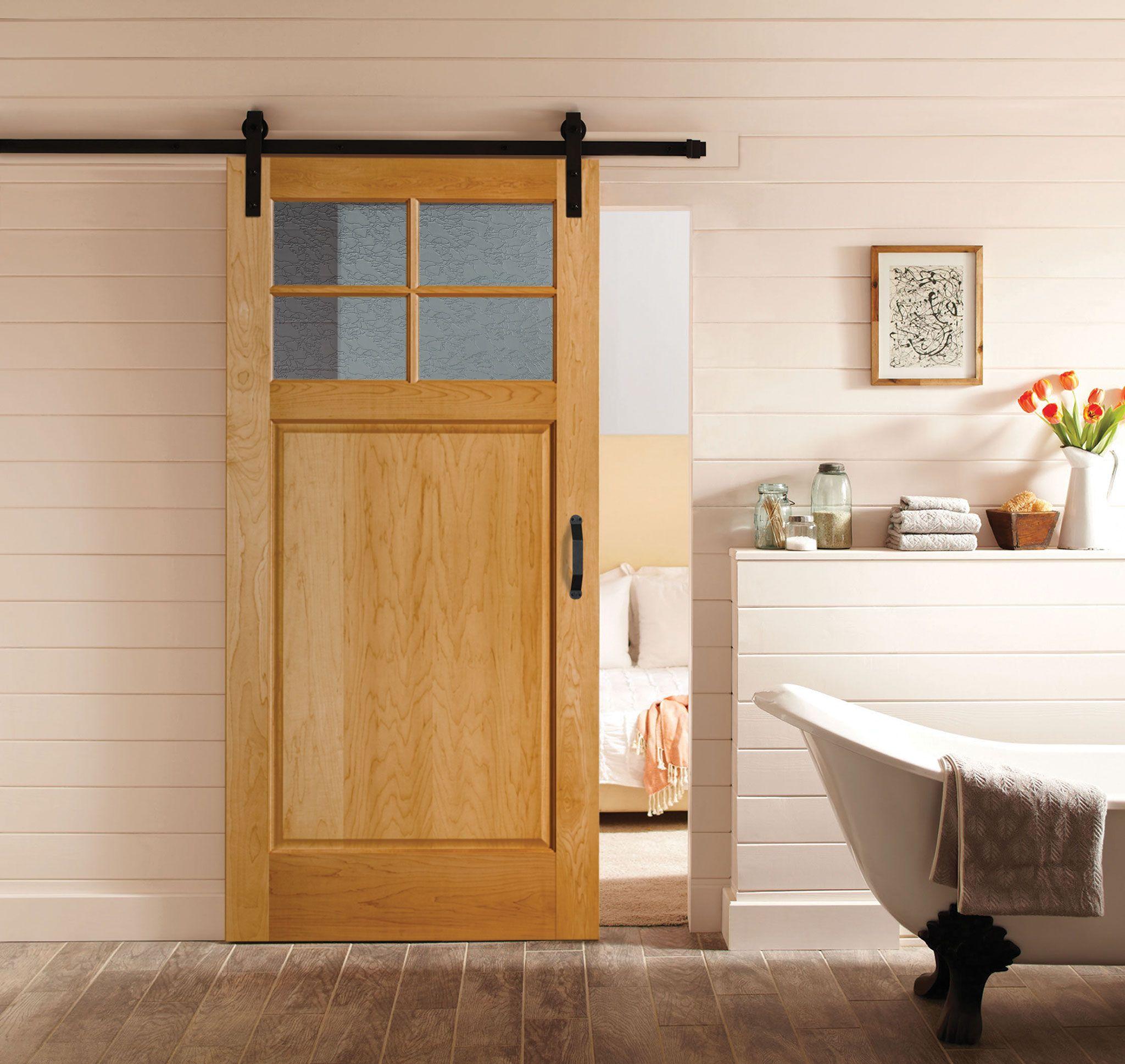 Wood Barn Door with glass in a bathroom