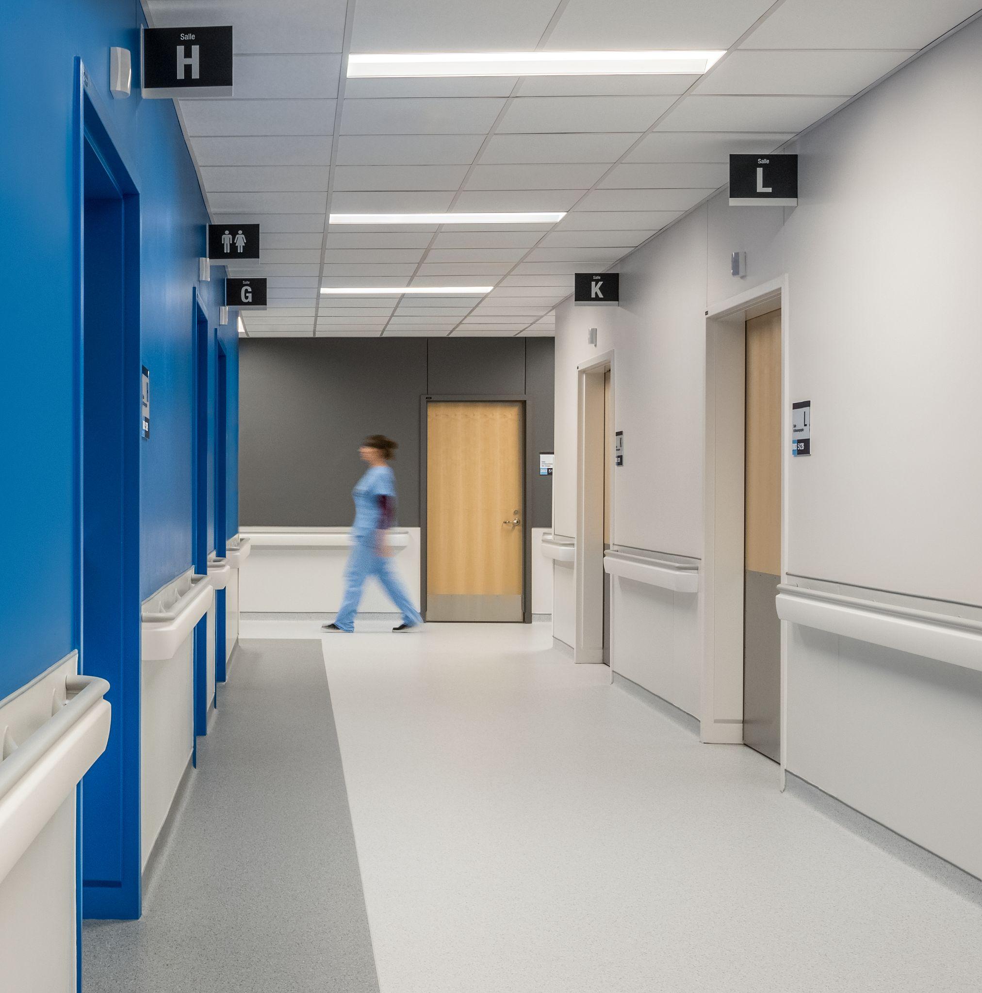 hospital hallway with wooden doors