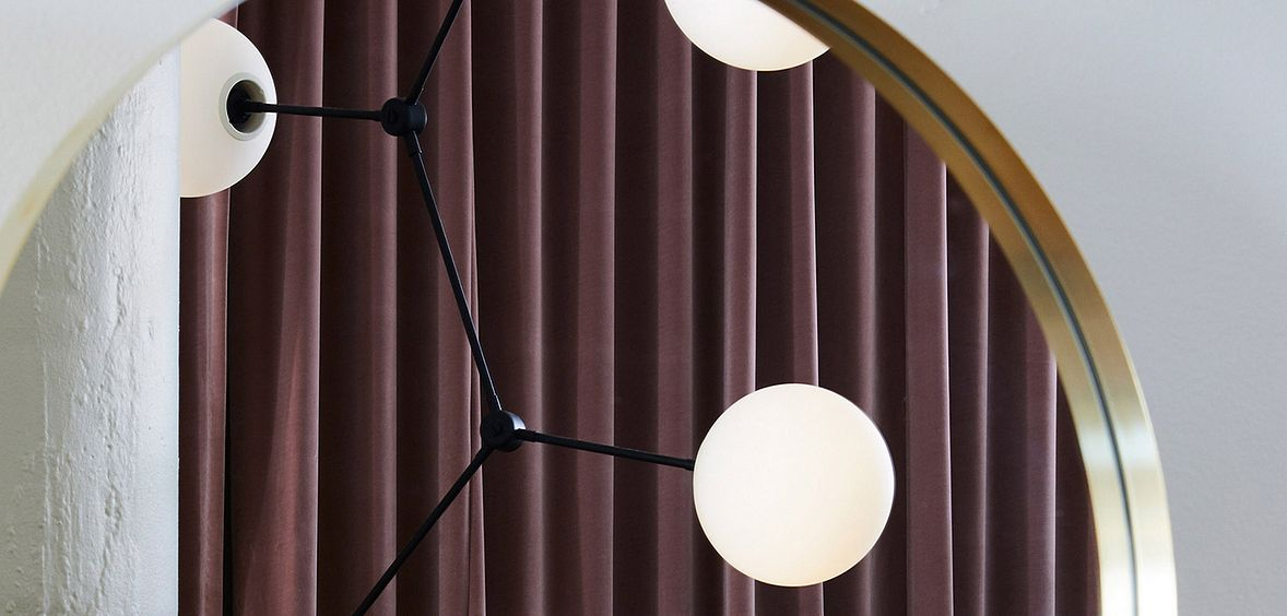 Nordic Noir trend uses simple light fixtures with clean lines