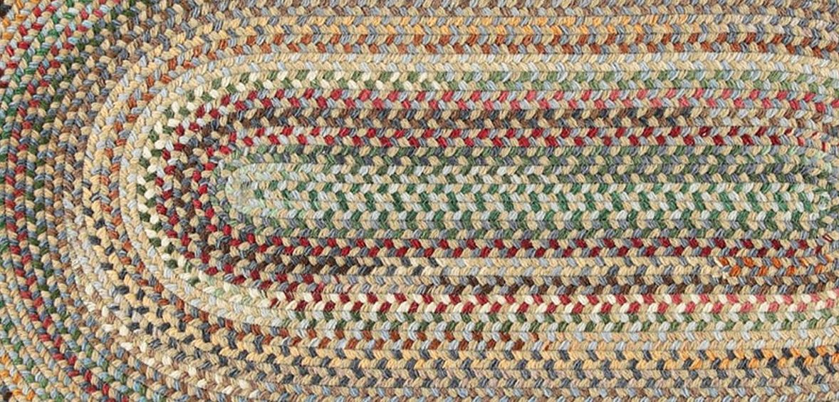 Multi-colored braided rug for Urban Country homes